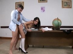 A brunette with a tight ass is getting penetrated in the school
