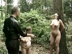 A couple of Master Ties Excited Servant To A Tree And besides Bangs Her With A Sextoy And besides Pulls On Her Nipples While Her Friend Is Viewing