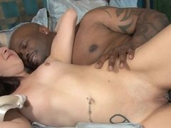 Pretty young white girl in bed with a thick black cock