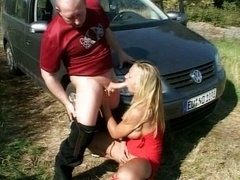 German couple in front of their car