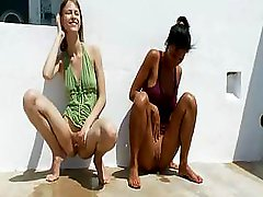 A couple of hot girls peeing in public