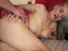 A granny with saggy boobs and a hairy pussy is fucked really hard