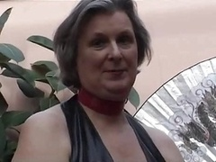 Mature In Fetish Wear Playing