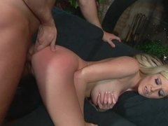 A milf with large fake boobs is getting tit fucked in this scene