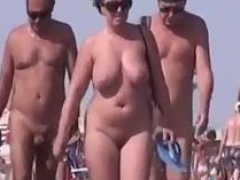 Walkers on Undressed Beach