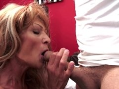 A granny that loves large thick cock feels one in her wet and juicy snatch