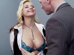 A blonde gets her tits and pussy licked in the office by her boos