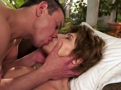 Kinky sex scene with a horny brunette granny and a young stud