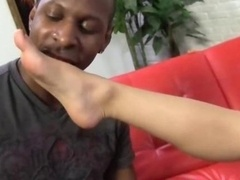Remy LaCroix does footjob on a long ebony meat rod with her teen feet