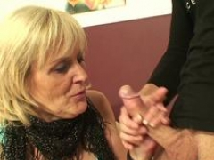 Blonde granny blows a young and fresh man's love tool with delight