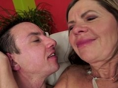 A granny with saggy tits really loves receiving young cock