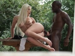 A black dude is shoving his dick into a sexy blonde with a hot pussy
