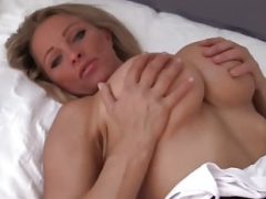 Hot blonde takes a load on her bulky titties