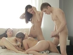 Three girls make one dude very happy by doing a foursome with the guy
