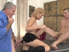 A blonde that loves hard cocks is fucked by a father and son