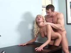 A blonde with a nice ass is feeling a cock in her slim body