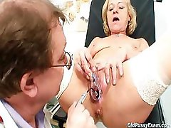 Blond granny squirting during a gyno inspection