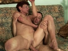 A nasty old woman receives a young cock in her meaty pussy