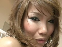 A milf Asian that loves her dildo pours oil on her chest on the stairs