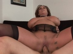 A hot milf with big boobs is getting licked and fucked in her cunt