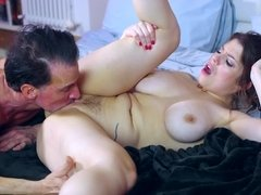 A woman that has big natural tits is getting licked by her lover