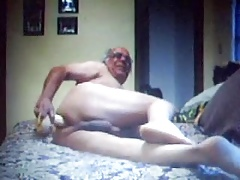 Sexy grandpa playing with a dildo