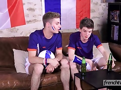 Two twinks support the French Soccer team in their own way
