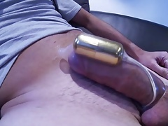 A cumshot with an e-stimulator in a condom