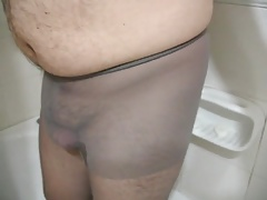 man with pantyhose in shower