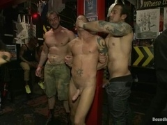 A handsome faggot gets fucked while being shackled