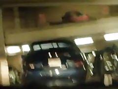 A wanker in a parking garage