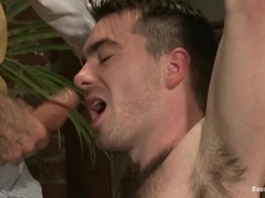 Colton Steele gets whipped and enjoys having a hook in his ass