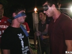A few gays rub each other's boners at some crazy outdoor party