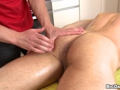 Bald poofter enjoys massage and fucks the masseur's ass from behind.