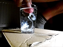 Shooting cum in a glass of water
