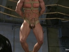 Derek Pain gets suspended and fucked by two latex gays