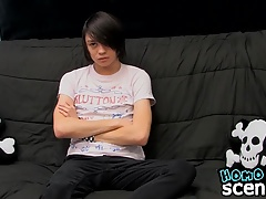 Emo twink Roxy Red enjoys a glass dildo while he wanks
