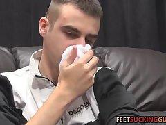 Moonek lays back rubs his sneakers and admires his feet