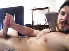 Sexy guy cums on his hairy chest