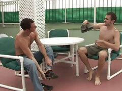 Two ripped gay studs fuck by the pool