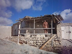 naked man at a fishing hut