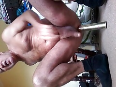 mature man uses chair leg for sex pleasure