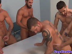 Tattooed hunks in group blowing load after anal