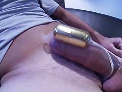 A cumshot with an e-stimulator in a condom
