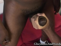 Tattooed daddy gives hand to a horny black gay hunk
