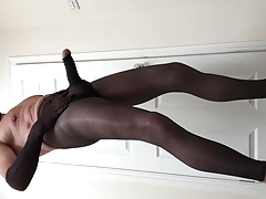 Footless tights with cock sleeve, nylon gloves and lace mask