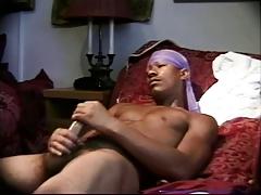 Guy masturbates on the couch