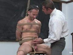 Nick Moretti gets his mouth and ass drilled in stunning gay BDSM video