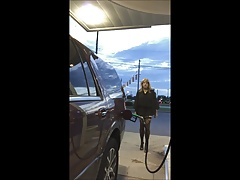 Gassing up in mini-dress