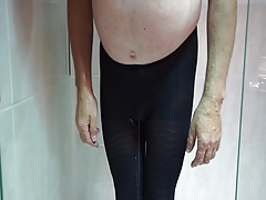 wetting black pantyhose